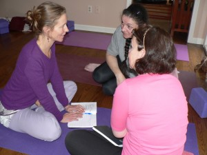 Discussing intentions and yoga practice.